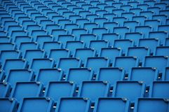 Blue folding plastic seats stock photography