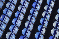 Blue folding seats in a stadium Stock Images