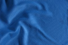 Blue football Jersey. Close up shot of blue textured football jersey Royalty Free Stock Photography