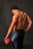 Blue football muscular back Royalty Free Stock Photography