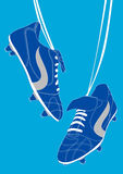 Blue football shoes Stock Photography