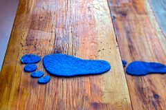 Blue footprints on wooden stairs. Close view Stock Photos