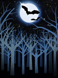 Blue forest and full moon with bats Stock Image