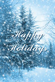 Blue forest Happy Holidays. Enchanted blue forest Happy Holidays card Royalty Free Stock Photography