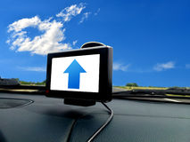 Blue forward arrow on gps system Stock Photography