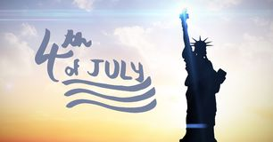 Blue fourth of July graphic against evening sky with statue of liberty. Digital composite of Blue fourth of July graphic against evening sky with statue of royalty free illustration