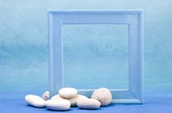 Blue frame. With white pebble Stock Image