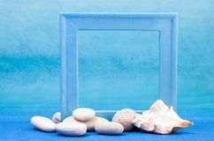 Blue frame. With pebble and sea shell Royalty Free Stock Photography