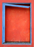 Blue frame on a boarded window Royalty Free Stock Photo