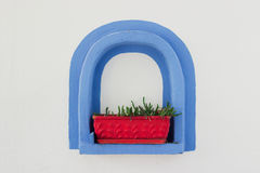 Blue frame. Decorative blue arch frame on the white wall Royalty Free Stock Image