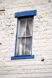 Blue Framed Window. A blue framed old window on white bricks Royalty Free Stock Photography