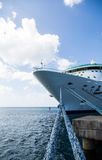 Blue Frayed Rope to Cruise Ship. Luxury Cruise Ship Anchored Under Nice Skies at Harbor on St Croix Stock Photography