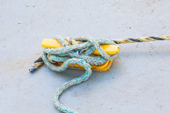 Blue Frayed Rope on Yellow Cleat Stock Images