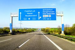 Blue freeway sign over the road in Germany on sunny day Stock Photography