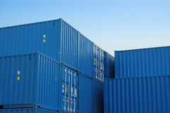 Blue freight containers. The blue freight containers waiting to be loaded Royalty Free Stock Image