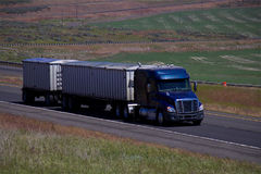Blue Freightliner / Double Grain Trailers Stock Photos