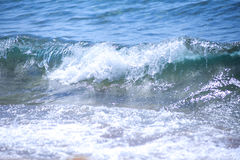Blue Fresh Water Whitecap Waves Wash Ashore onto a Sandy Beach. Royalty Free Stock Images
