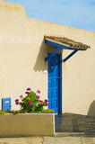 Blue front door with pink flowers Stock Photography