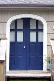 Blue Front entry double doors next to shake siding Royalty Free Stock Photos