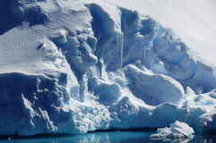Blue frost. Blue frozen parts of a gigantic Antarctic iceberg Stock Image