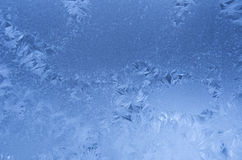 Blue frost pattern. Slightly blurred blue frost pattern on a window glass (as an abstract winter background Royalty Free Stock Photo