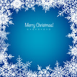 Blue frosty Christmas snowflakes background Stock Image