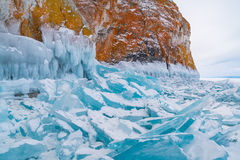 Blue frozen water covered with snow and icicles Royalty Free Stock Photos