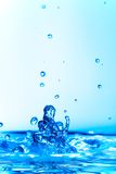 Blue frozen water splash Stock Images
