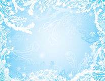 Blue frozen winter background with snowflakes Royalty Free Stock Image