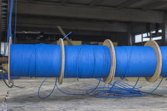 Blue ftp ethernet cable reels. On a building site. Installing ftp cable in industrial building. Selective focus stock photography