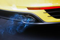 Blue fuel gas pollution car exhaust pipe Royalty Free Stock Photography