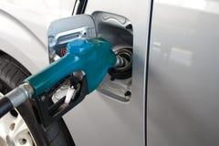 Blue Fuel nozzle add fuel in car Stock Photo