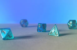 Blue game dice d4 Stock Images