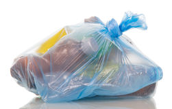 Blue garbage bag with household waste isolated on white. Stock Photo