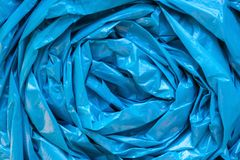 Blue garbage bag texture. Cellophane twisted crumpled plastic ba Royalty Free Stock Photos