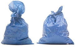 Blue garbage bag with trash Royalty Free Stock Image
