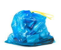 Blue garbage bag with trash Royalty Free Stock Images