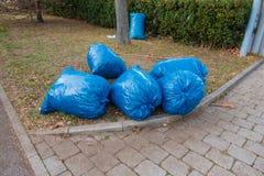 Blue garbage bags Stock Photos
