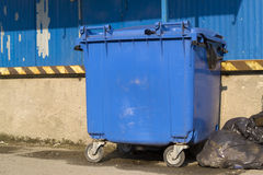 Blue garbage bin Stock Photos