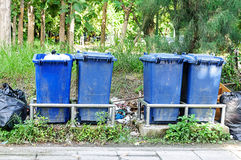 Blue garbage cans Stock Image