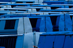 Blue garbage containers. A large collection of blue garbage containers or dumpsters stock photos