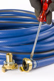 A blue garden hose with coupling Royalty Free Stock Photos