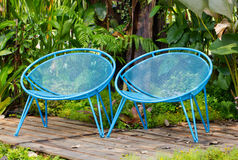 Blue Garden Metal Chairs. Blue Garden Metal Chairs For Exterior Decorated Stock Photos