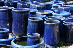 Blue garden pots. A collection of large, blue, ceramic garden pots Royalty Free Stock Photo