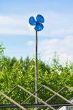 Blue Garden Windmill Stock Images