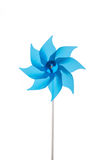 Blue garden windmill isolated over white background. Stock Photo