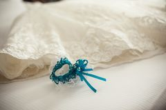 Blue garter of the bride and dress royalty free stock image