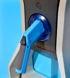 Blue gas pump machine and fuel gun. Sample royalty free stock photography