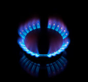 Blue gas stove in the dark Royalty Free Stock Images