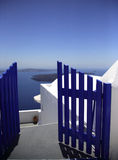 Blue gate. Leading you to the beautiful bay Santorini Greece Stock Photography